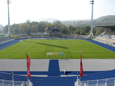 The blue Regupol® synthetic athletic track at the Ernst-Abbe-Stadium in Jena, Germany.