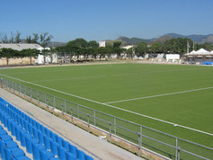 Football field surrounded by a Park area covered with Regupol® Elastic Shock Pads for Artificial Turf