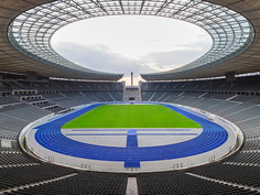 Usain Bolt set his two world records in Berlin. The blue tartan track was built by REGUPOL.